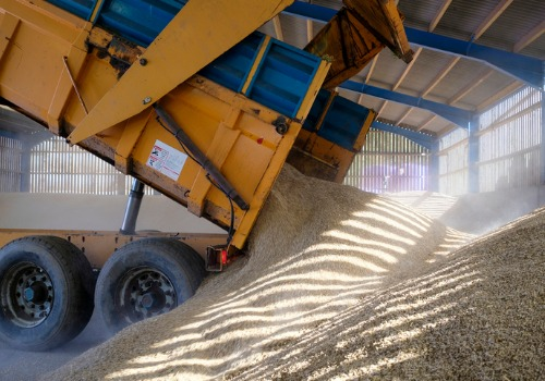 A truck unloading grain during a grain delivery