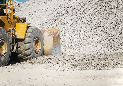 A tractor picking up rock as part of a Rock and Lime Delivery